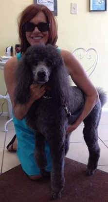 photo, happy cutomer and her standard poodle